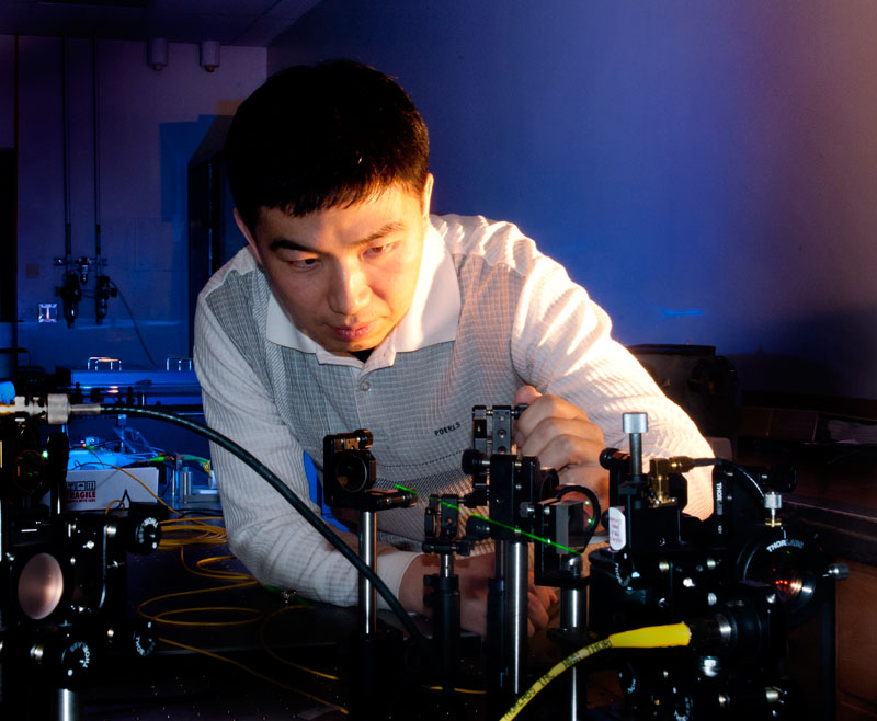Physicist Dr. Lingze Duan at work in a UAHuntsville lab. Dr. Duan has been awarded a five-year, $400,000 National Science Foundation grant.