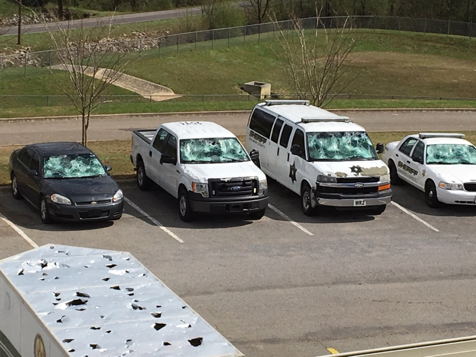 Vehicles parked outside the Cullman Sheriff's Department were battered and smashed by hailstones that fell March 19, 2018