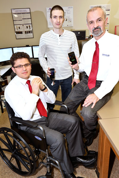 From left, Dr. Aleksandar Milenkovic, doctoral student and graduate assistant Mladen Milosevic and Dr. Emil Jovanov demonstrate one mHealth technology. The program developed at UA Huntsville uses the sensors in smart phones to monitor wheelchair use.