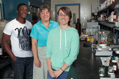UAH Chemistry professor Dr. Carmen Scholz with doctoral candidate Samuel Nkrumah-Agyeefi and junior Brittany Black in a lab at the Materials Science Building.