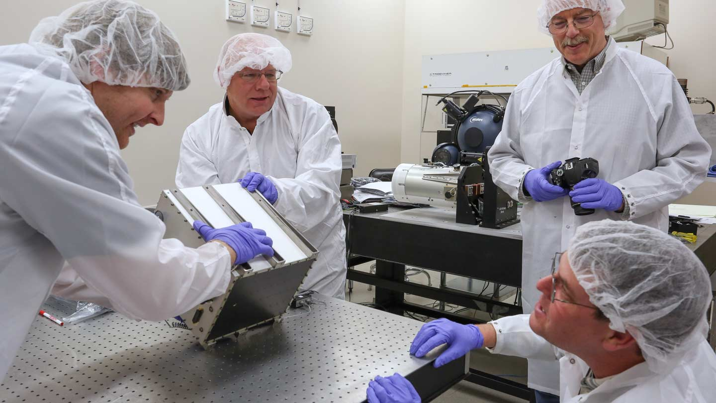 Clockwise from left, RSESC research scientist Thor Wilson, MSFC's Steve Pavelitz, ESSC principal research scientist Mike Stewart and MFSC's Brents Pepper