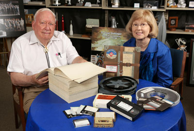 Dr. Charles Lundquist, director of Interactive Projects at the UAH Research Center, and Anne Coleman, reference librarian and head of Archives and Special Collections, with obsolete media containing data from the U.S. space program. The IBM printout that Dr. Lundquist is reading is the only surviving copy of the telemetry he needed for research from NASA's Gravity Probe A mission. The original tape from the 1976 flight is no longer readable.
