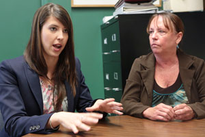 Kristin Weger, left, discusses study results with Dr. Sandra Carpenter.