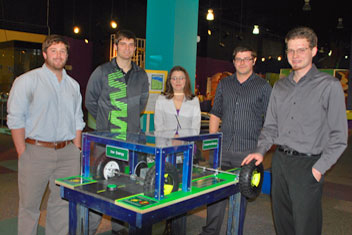 Students in a University of Alabama in Huntsville Mechanical and Aerospace (MAE) capstone design class created a new Sci-Quest exhibit that shows how hybrid cars store and expend energy. From left are Chandler Wicks, Jordan Steelman, Jeannette Zatowski, Dakota Gomez and Paul Fryer.