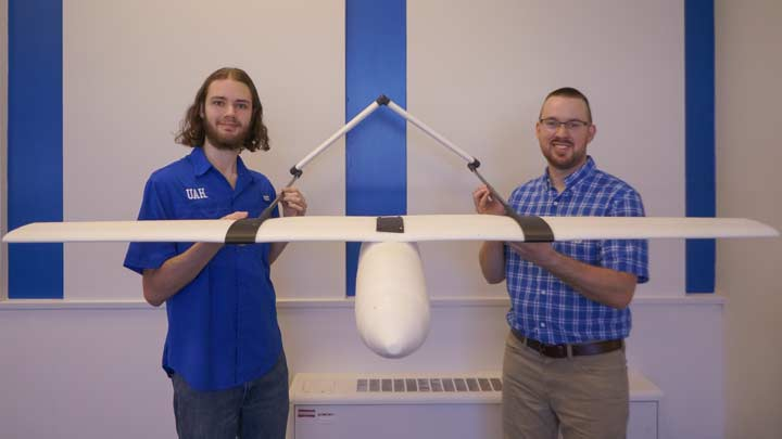 Chris Sallis and Nick Balch hold their rigid closed cell foam fixed-wing aircraft
