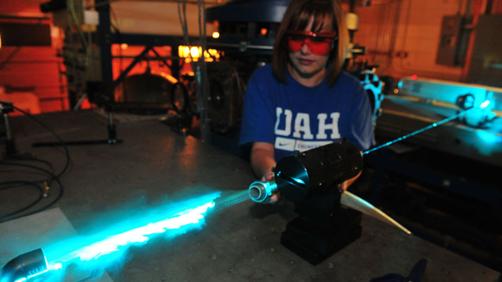 Student with blue laser